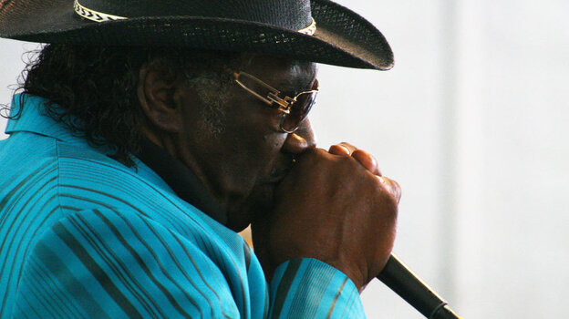 Mississippi-born harmonica player Big George Brock performs at the Philadelphia Folk Festival.