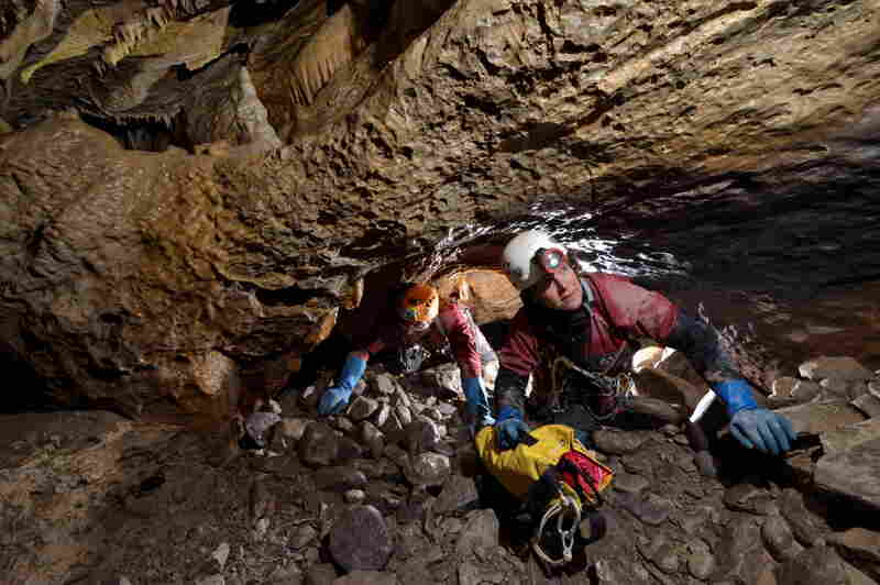 Cavers crawl through a 10-meter-long (about 33 feet) section of the cave.