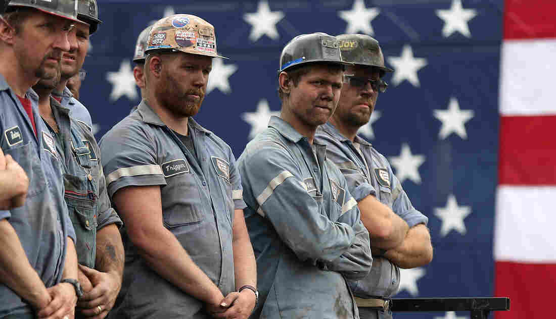Coal miners listened as GOP presidential nominee Mitt Romney spoke during a rally last month in Beallsville, Ohio. Both Romney and President Obama have made the state a focal point of their campaigns.