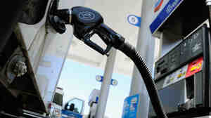 Higher prices at the pump meant the amount of money consumers spent went up last month.