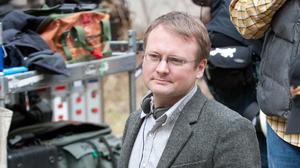 Director Rian Johnson on the set of Looper.