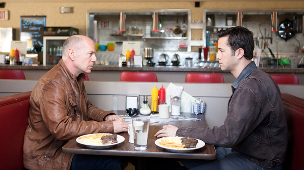 Bruce Willis and Joseph Gordon-Levitt play different versions of the same character in the time-travel thriller Looper. (Sony Pictures)
