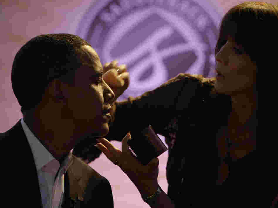 Then-Sen. Barack Obama gets makeup applied at a presidential candidate forum in Lake Forest, Calif., on Aug. 16, 2008.