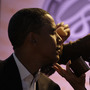 Then-Sen. Barack Obama gets makeup applied at a presidential candidate forum in Lake Forest, C
