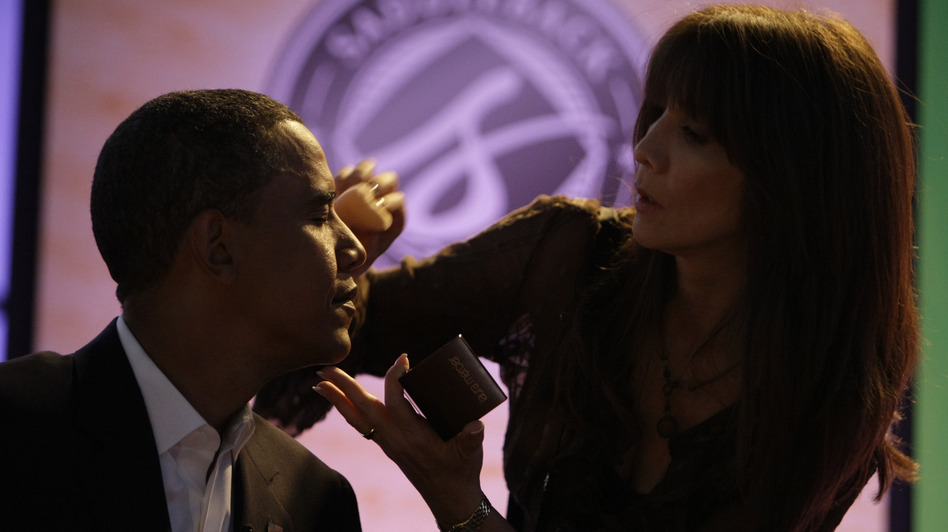 Then-Sen. Barack Obama gets makeup applied at a presidential candidate forum in Lake Forest, Calif., on Aug. 16, 2008. (AP)