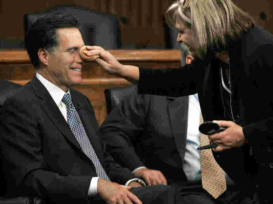 Mitt Romney has makeup applied before a discussion on Capitol Hill on Sept. 14, 2005.