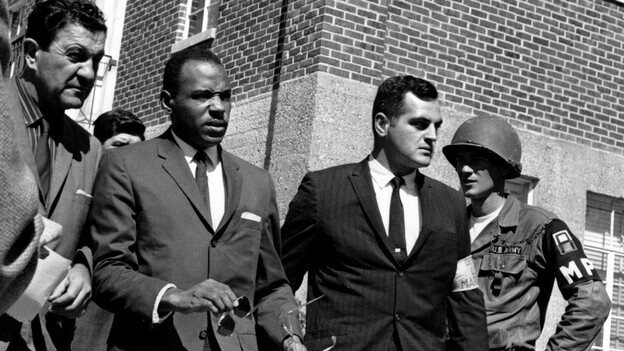 Meredith, center with briefcase, is escorted to the University of Mississippi campus by U.S. marshals on Oct. 1, 1962. (AP)