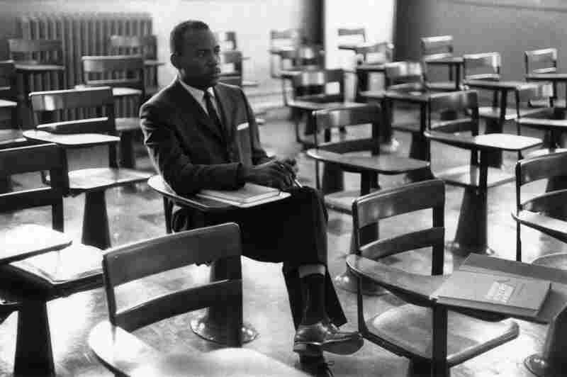 Meredith sits alone on his first day of class. A photographer who was there remembers the other students leaving the room in protest.