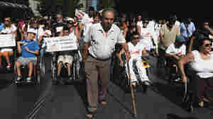 People with disabilities take part in a march against the government's new austerity measures in central Athens on Thursday.