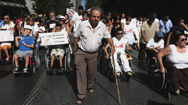 People with disabilities take part in a mar
