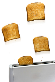 Toast flying out of a toaster.