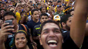 Supporters of opposition presidential candidate Henrique Capriles attend a campaign rally in Valencia, Venezuela, on Thursday. Capriles is running against President Hugo Chavez in the country's Oct. 7 election.