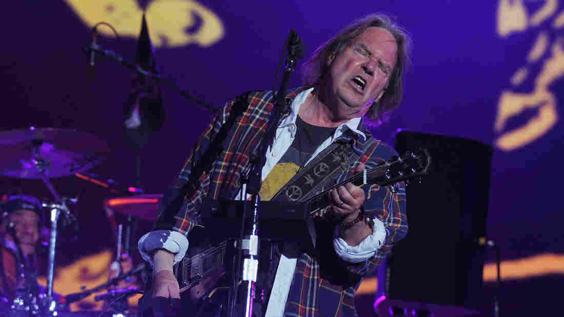 Neil Young onstage at the Global Citizen Festival in Central Park on Saturday. Guitar face.