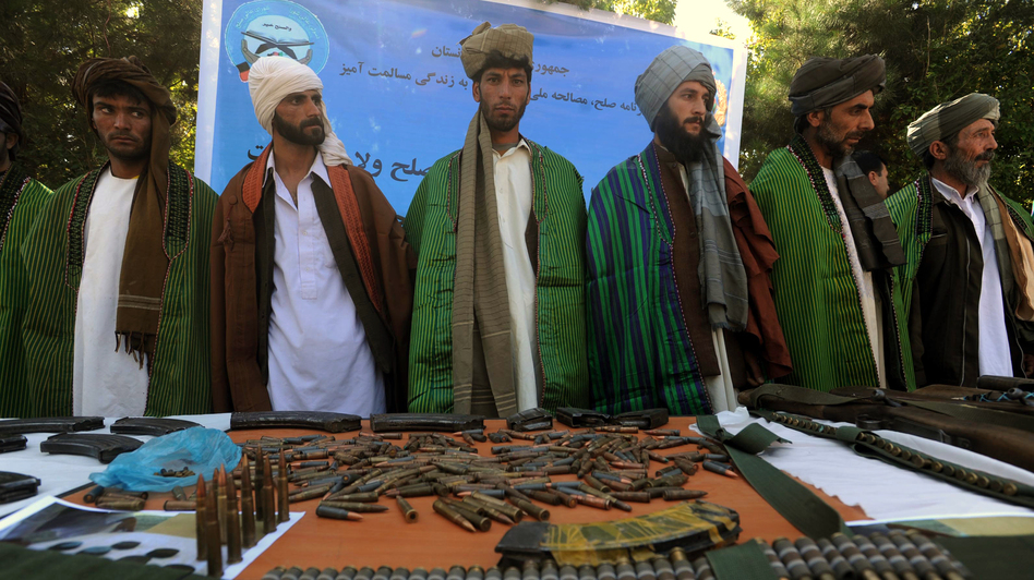 Former Taliban fighters display their weapons as they join Afghan government forces during a ceremony in Herat province on Sept. 18. (AFP/Getty Images)