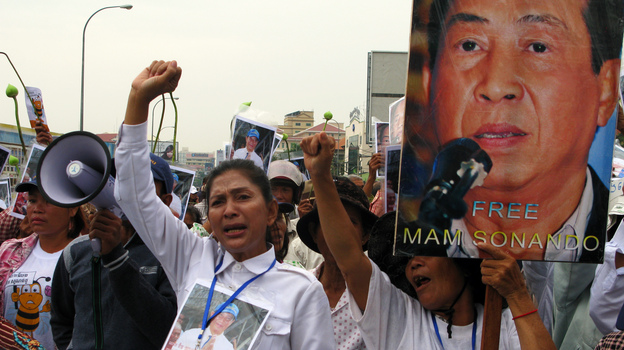 Supporters of Cambodian journalist Mam Sonando protest outside a Phnom Penh courthouse on Monday, when judges sentenced him to 20 years in jail for leading an alleged secession movement. Critics say the pro-democracy activist's case was politically motivated. (NPR)