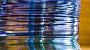 "This shot of a stack of CDs on photographer Mike Neilson's desk is captioned on his Flickr page like this: ""I have this stack of CDs that I don't know what to do with. I haven't played one in a long time now. Do used CD places still exist? Who would buy CDs, much less USED CDs at this point?"""