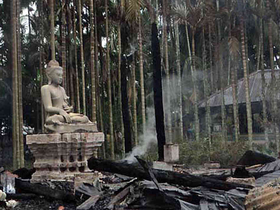 A statue of Lord Buddha is left standing amidst the torched ruins of the Lal Ching Buddhist temple at Ramu, Bangladesh. Thousands of rioters torched Buddhist temples and homes in southeaster