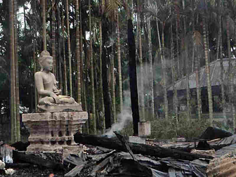 A statue of Lord Buddha is left standing amidst the torched ruins of the Lal Ching Buddhist temple at Ramu, Bangladesh. Thousands of rioters torched Buddhist temples and homes in southeastern Bangladesh Sunday over a photo posted on Facebook deemed offensive to Islam, in a rare attack against the community.