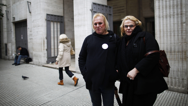 Transsexuals Maiamar Abrodos (right) and Maria Laura Aleman arrive at the civil registry to begin the legal process to change their genders in Buenos Aires, Argentina, in June. (AP)