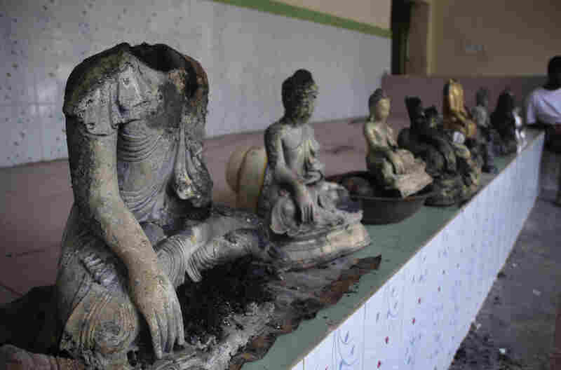 Damaged statues at a Buddhist temple that was torched in Ramu in the coastal district of Cox's Bazar, Bangladesh.