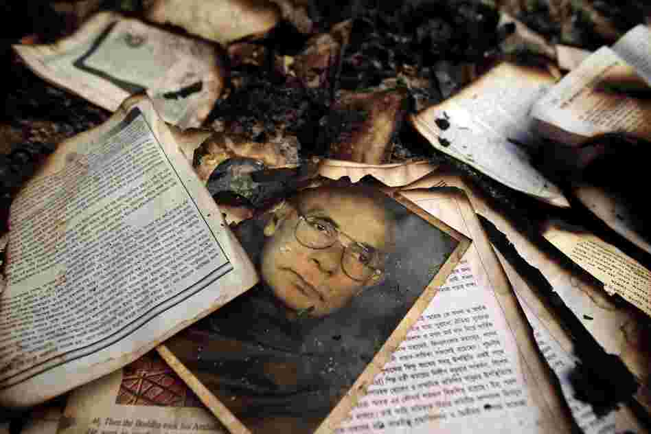 The remains of burned religious books at a Buddhist temple which was torched in an overnight weekend attack in Ramu in the coastal district of Cox's Bazar, Bangladesh.