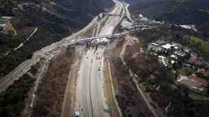 All clear: A section of the 405 freeway in Los Angeles was empty while crews worked over the weekend to demolish the Mulholland Bridge.