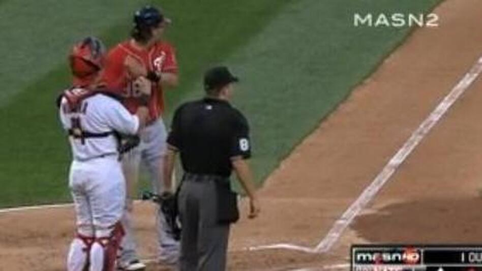 Michael Morse (in red) pretends to swing again before going on another home run trot. (Yahoo Sports)