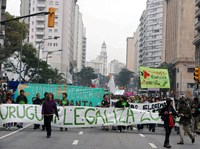 Supporters of legalization of cannabis in Montevideo march toward the Legislative Palace in May as part of the 2012 Global Marijuana March.