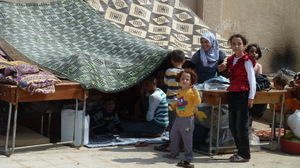 Syrian refugees live under makeshift tents in the grounds of a school in Atme, a village controlled by the Free Syrian Army.