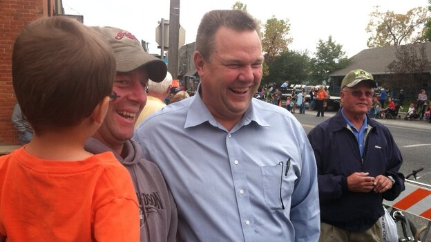 Sen. Jon Tester, D-Mont., (center) campaigns at a parade Saturday in Belgrade, Mont.