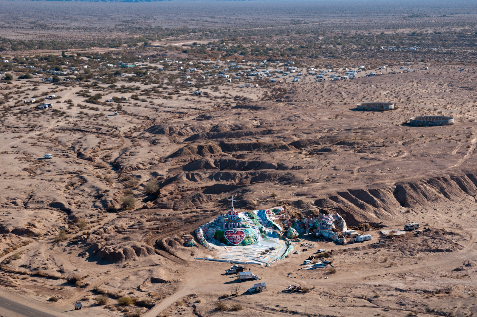 "Salvation Mountain, located near the main road to Slab City, was built by Leonard Knight out of adobe clay. At the center, Knight sculpted the words ""God Is Love"" -- what he says is a simple message he wanted to share with the world."