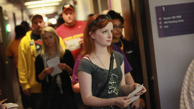 Students wait in line to vote last Friday on the campus of the University of Northern Iowa in Cedar Falls, a day after the swing state began in-person early voting. (Getty Images)