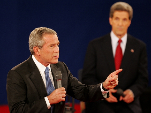 In a 2004 debate in St. Louis, President Bush answers a question as his opponent, Sen. John Kerry, listens. Both candidates used a number of