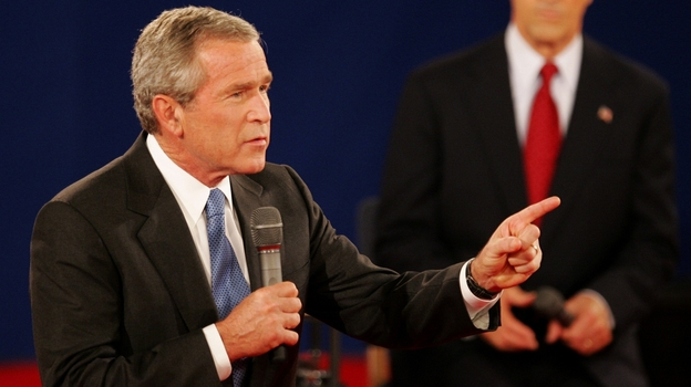 """In a 2004 debate in St. Louis, President Bush answers a question as his opponent, Sen. John Kerry, listens. Both candidates used a number of """"pivots"""" in their debates. (AP)"""