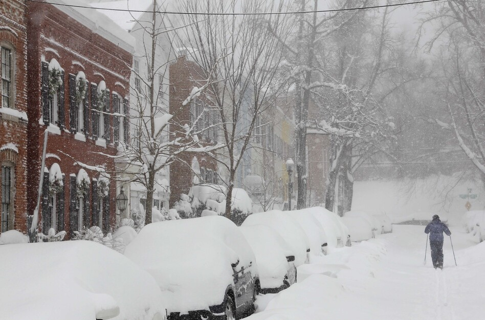 A person uses cross country skis to get up 26th Street NW near P Street in the snow in Washington in 2010.