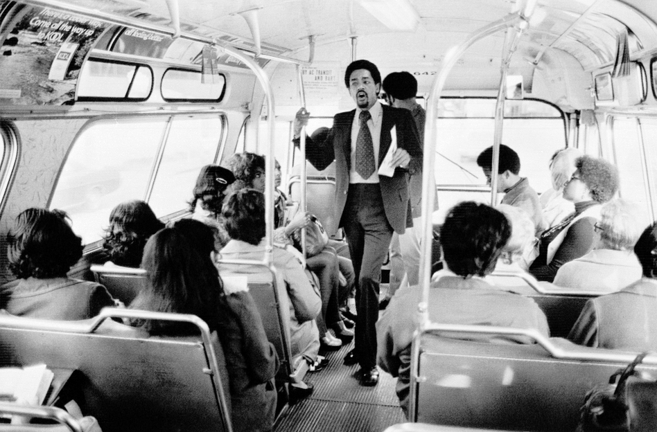 Bobby Seale, Panther chairman and co-founder, campaigns on a rush-hour bus in Oakland, Calif., on April 13, 1973, to be Oakland's mayor. He lost, coming in a close second place, showing the strength of the party in the city where they formed. (AP)