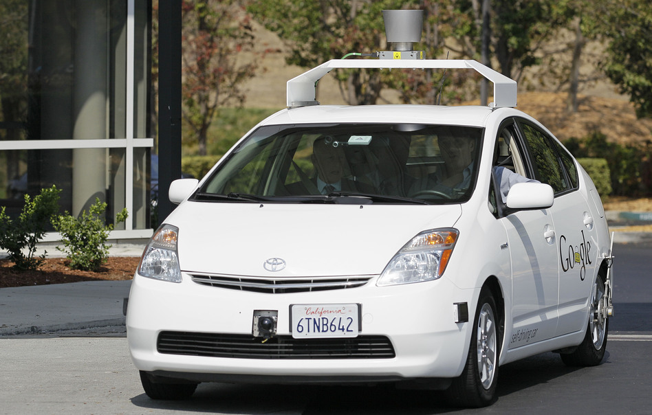 California Gov. Jerry Brown (front left) rides in a driverless car to a bill signing at Google headquarters in Mountain View, Calif., on Sept. 25.