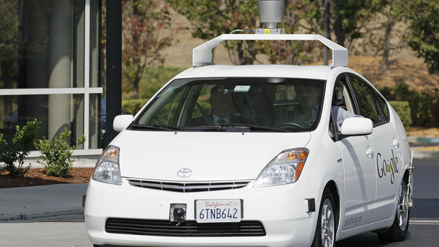 California Gov. Jerry Brown (front left) rides in a driverless car to a bill signing at Google headquarters in Mountain View, Calif., on Sept. 25. (AP)