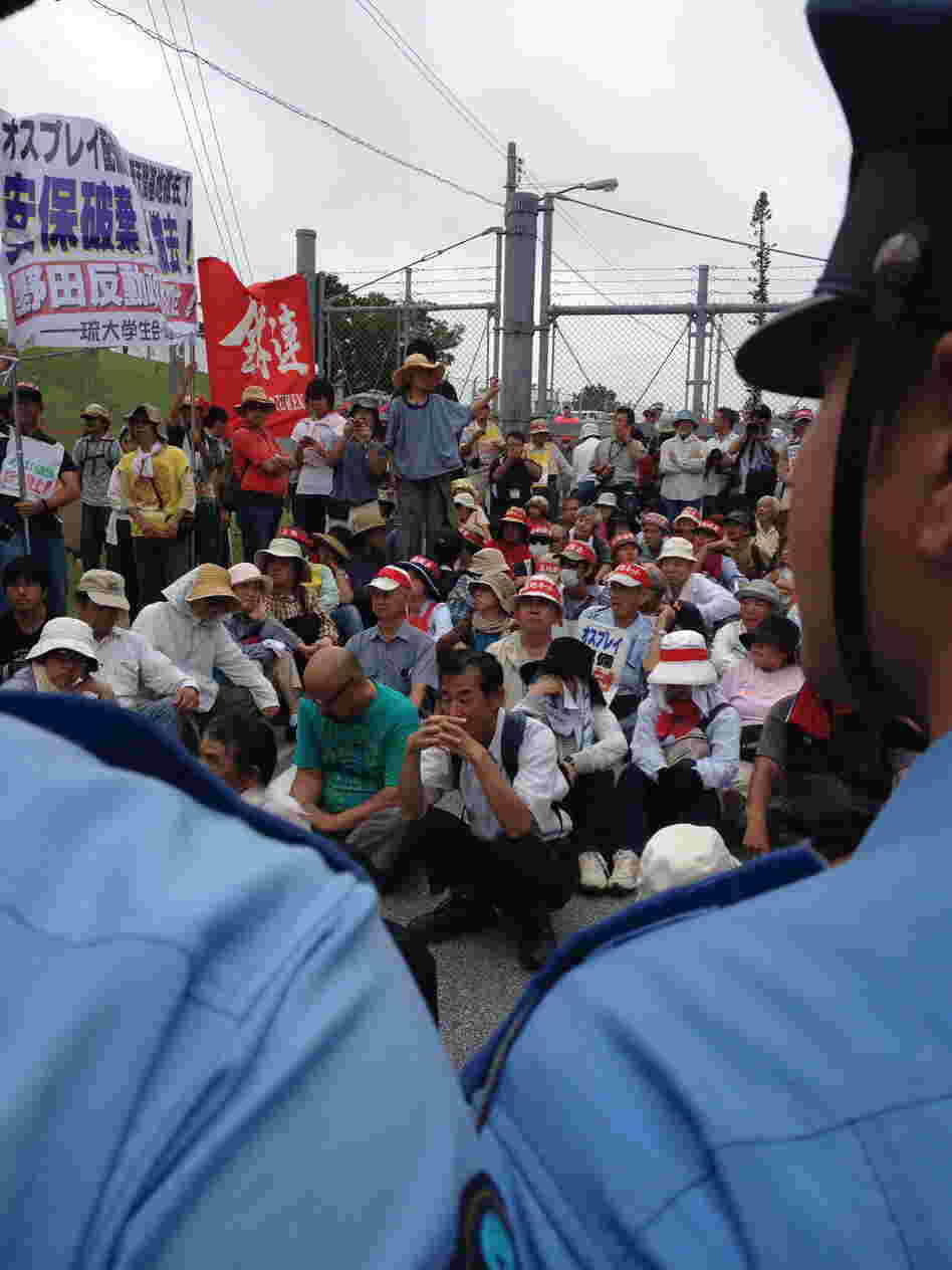 Protesters block an entrance to U.S. Marine Corps Air Station Futenma in Ginowan, Japan.