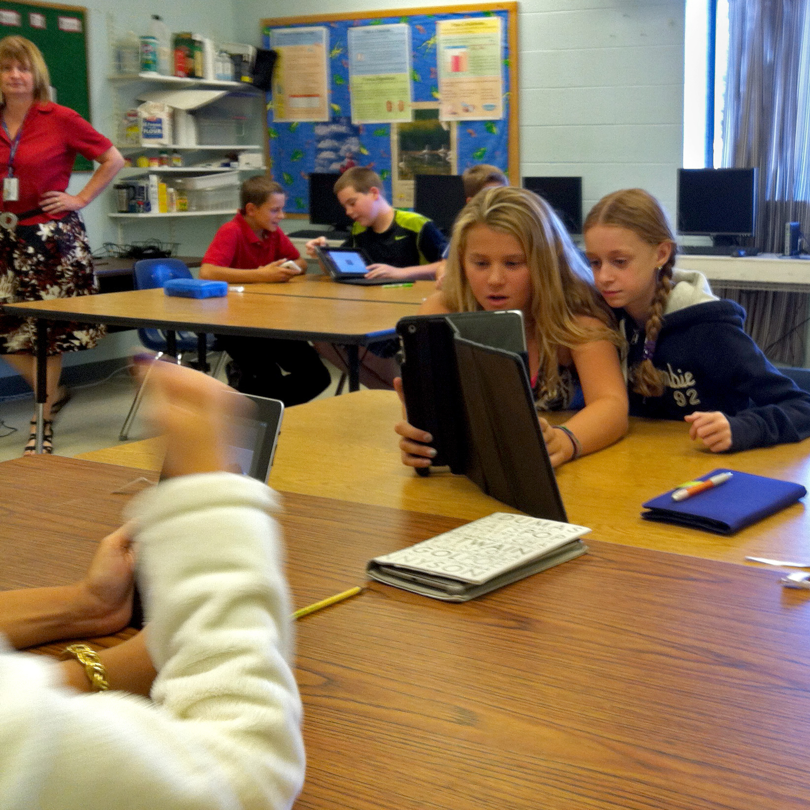 Oyster River students Hannah Croasdale and Jordan Hillyard experiment with Screen Chomp, another free app that teachers hope kids will use to ask each other for help on homework problems.