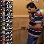 An Iranian man checks the rates of foreign currencies at a currency exchange bureau in central Tehran on Sept. 29. The Iranian currency lost nearly one-third of its value in a day over the weekend.
