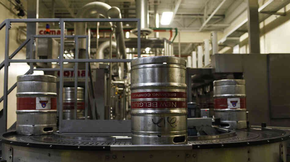 Beer is processed at the New Belgium Brewery in Fort Collins, Colo. The brewery has embraced sustainability, making efforts to produce some of its own energy.