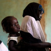 Women and their children wait for medication and instructions on how to use it at the clinic in Dareta, Nigeria. Treating children with high levels of lead is a painstaking process that works only if their environment at home is free from lead.