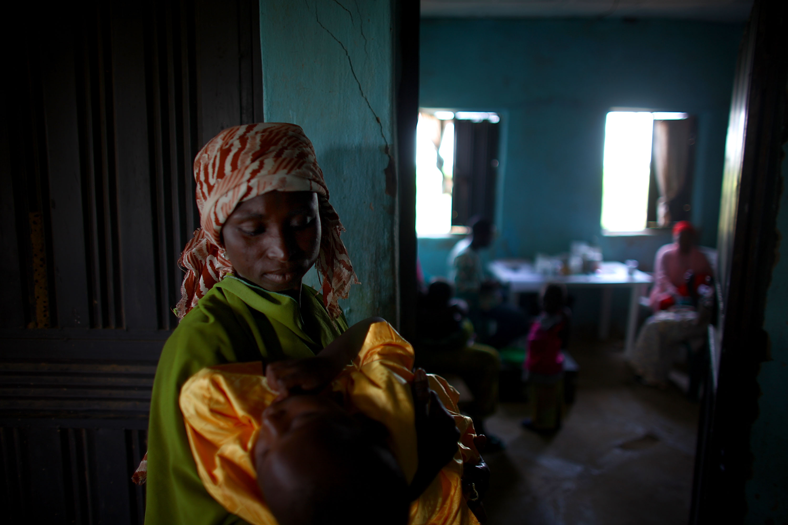 Gado Labbo holds her 5-year-old son, Yusuf, at the clinic in Dareta. In 2010, when Yusuf first entered the clinic, he had a blood lead level of 150 micrograms per deciliter -- 30 times higher than what the Centers for Disease Control and Prevention considers dangerous.