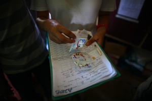 Susan Lake, a nurse for Doctors Without Borders, goes over the list of pills for one of her patients at the clinic in Dareta. More than 400 kids have already died from lead poisoning, while thousands of others are stunted physically and mentally.