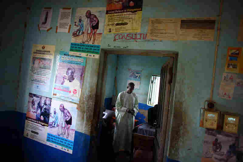 A local health official stands in the consultation room of a health clinic and hospital in Bagega, Nigeria. At first, miners in the region were processing lead-laden gold ore inside their homes. Doctors Without Borders persuaded most of them to move the processing to the outskirts of town.