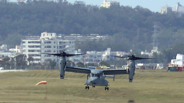An Osprey arrives at U.S. Marine Corps Air Station Futenma in Ginowan city on Japan's southern island of Okinawa on Monday. Six Ospreys were deployed in Okinawa, drawing sharp reactions from residents amid persistent concerns about the aircraft's safety. (AFP/Getty Images)