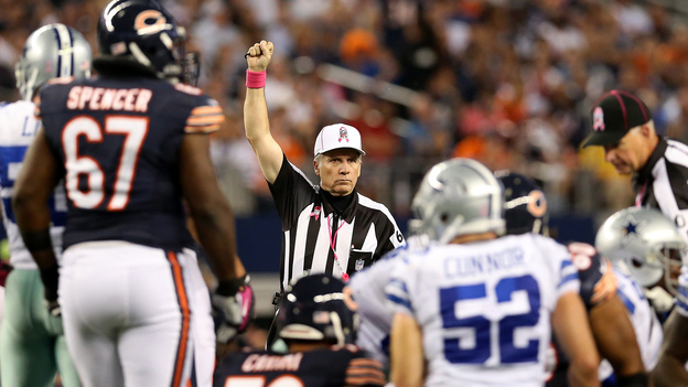 Referee Walt Anderson makes a call in the Chicago Bears game against the Dallas Cowboys Monday, ending the NFL's first full slate of games with its regular officials. (Getty Images)