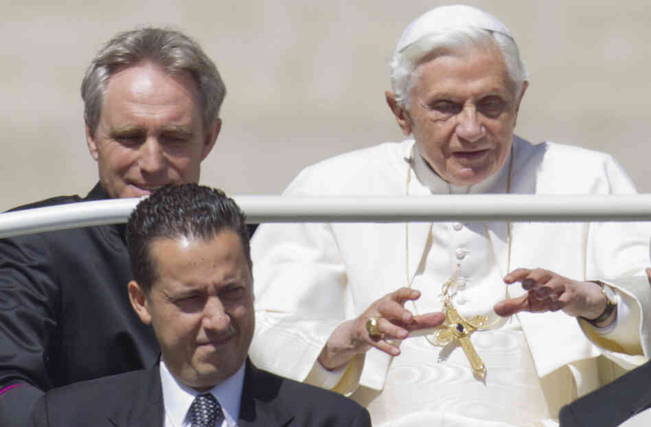 Pope Benedict XVI and his former butler, Paolo Gabriele (center), are shown at the Vatican in this file photo. The pope's private secretary, Georg Gaenswein, is on the left.