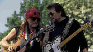 Willie Nelson (left) and Waylon Jennings, members of the country supergroup The Highwaymen, perform at a concert in Central Park in 1993.